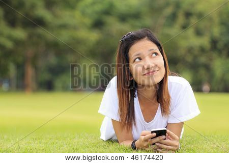 Woman doing activity on her mobile phone in outdoor