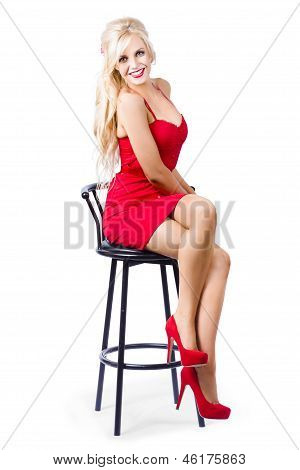 Blond Female Bistro Babe On Bar Stool In Red Dress