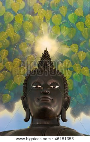 Buddha's statue looking down kindly with an aura on this head shining to console all living things poster