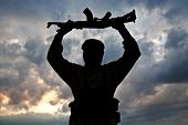 Silhouette of muslim militant with rifle. See my other works in portfolio. poster
