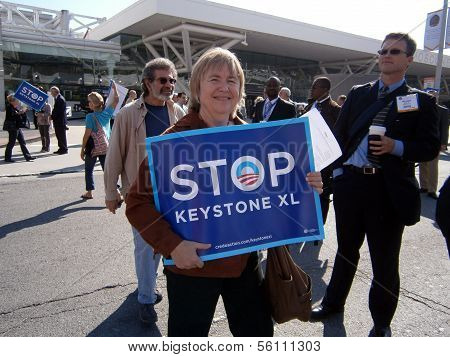 Female Protester Hold Large Signs Saying 'stop Keystone Xl' On Howard Street During Protest