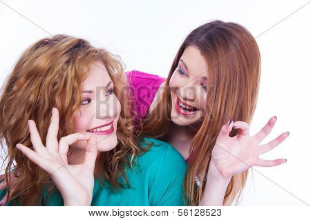 Young lighthearted girls shows Okay gesture