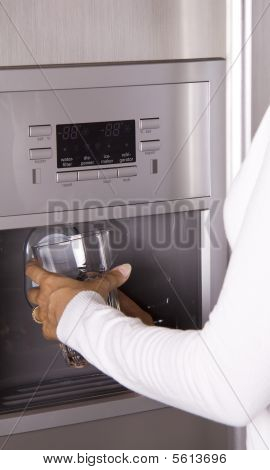 Getting Ice From The Refrigerator