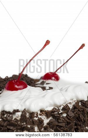Cake with cherry isolated on white