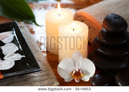 Relaxing Spa With Candles Orchids Towels And Stones