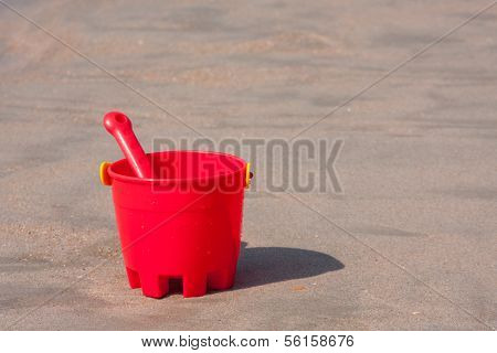 Red Sand Bucket And Shovel