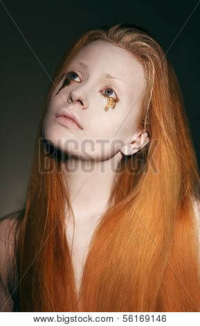 Stylized Woman With White Makeover And Golden Tears