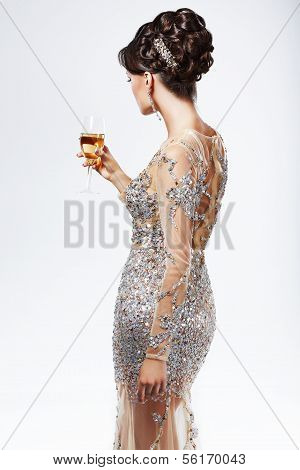 Elegant Woman In Silver-golden Dress Holding Wineglass Of Champagne. Luxury