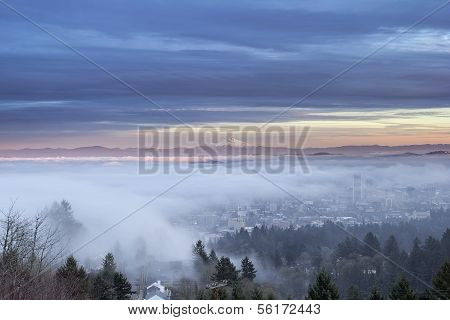 Portland Oregon Downtown Cityscape Covered in Fog and Low Clouds at Sunset with Mount Hood poster