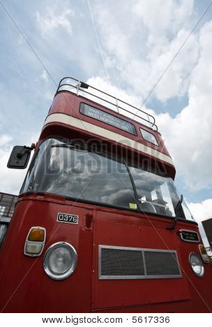 classic red london doubleheader platform bus view from below front poster