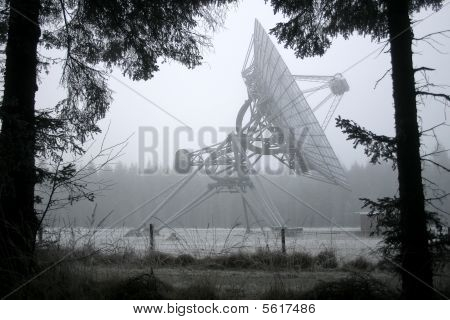 A Dish Telescope In The Forest In Winter