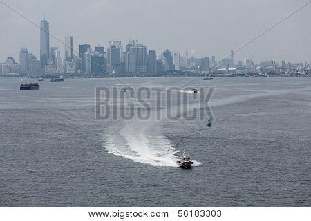 A New York City Police Boat Speeding Across the harbor near Manhattan poster