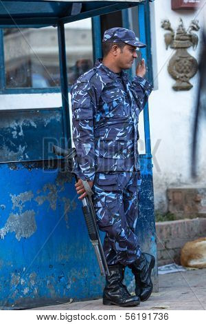 KATHMANDU, NEPAL - DEC 2: Unidentified guard police of King Tribhuwan Memorial Museum near Durbar square, Dec 2, 2013 in Kathmandu, Nepal.