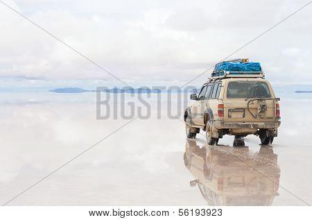 Off-road car on lake Salar de Uyuni, Bolivia