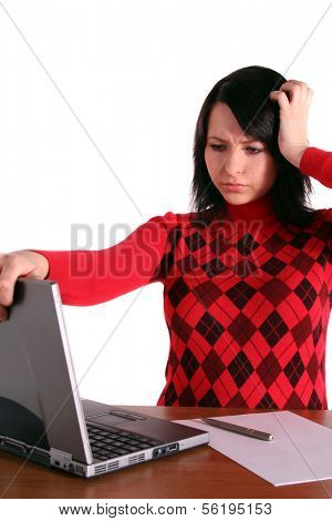 A handsome student got a problem with her notebook computer. All isolated on white background. poster