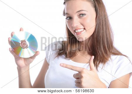 An attractive young woman holding a CD-Rom or DVD.  All isolated on white background.