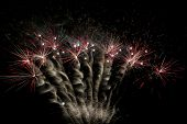 Magnificent fireworks display exploding across the night sky poster