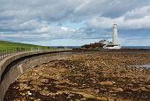 Flood defences and promenade to st marys lighthouse near tynemouth on the North East Coast of England. poster