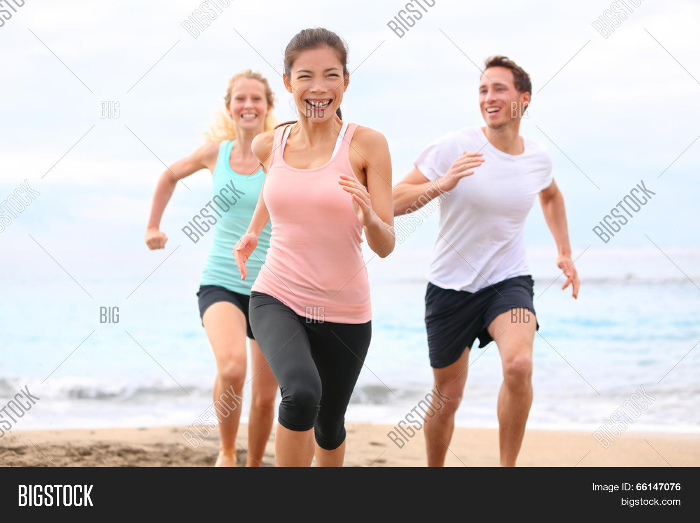 Group Running On Beach Image Photo Free Trial Bigstock