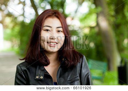 Mongolian Woman In Park