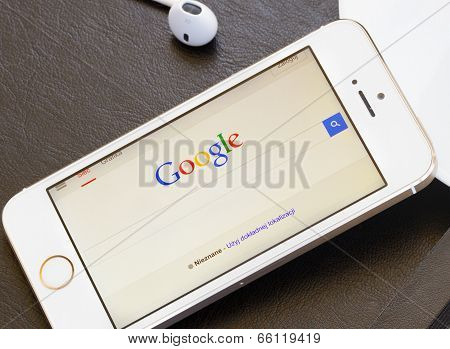WARSZAWA, POLAND - APRIL 01, 2014. Google search page on screen of Iphone 5s.  In December 2013 Alex