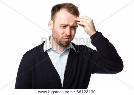 Young Man Grimacing With Pain
