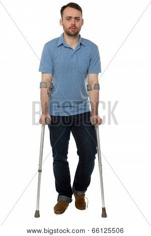 Young Disabled Man Walking With Forearm Crutches