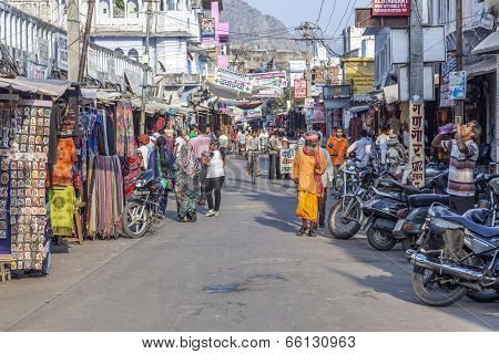 People Walk Around Pushkar In The Main Street