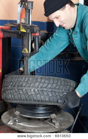 Mechanic In Garage