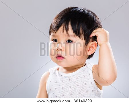 Baby boy scratch head