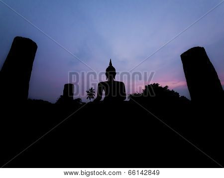 Silhouette Buddha Image At Twilight At Wat Mahathat Sukhothai Thailand