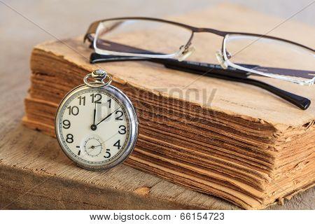 Pocket Watch Next To Book