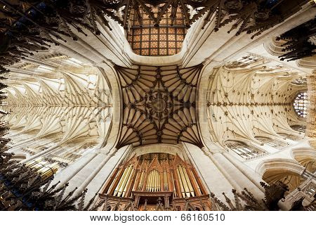 Winchester, Hampshire, UK - May 15, 2014: Fish-eye view of the vaulted ceiling and the organ at Winchester Cathedral.
