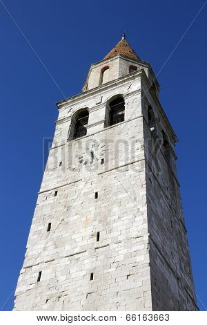 Historic High Bell Tower Of The Town Of Aquileia Seen From Below