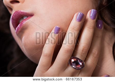 Close-up Of Woman's Hand Wearing Diamond Ring