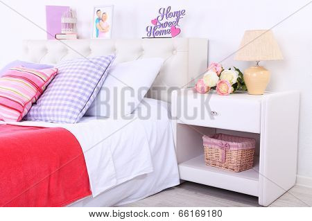 Comfortable soft bed in room