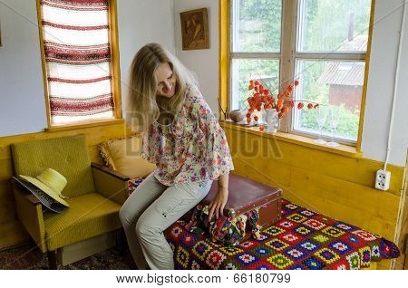 Young Woman Sitting Overstuffed Suitcase In Bed