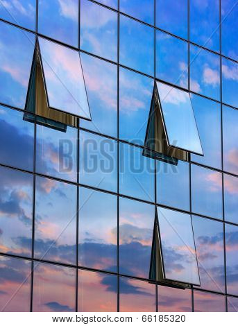Reflection In Open Windows  Of  Skyscraper At Sunset