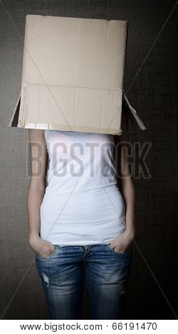 faceless girl with box on her head, toned