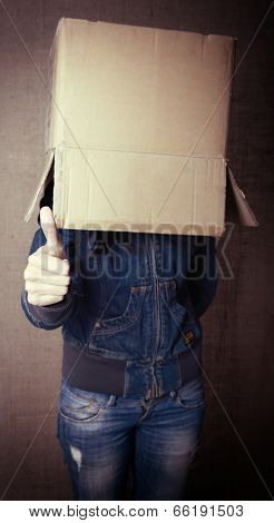 faceless girl with box on her head LIKE with thumb up, social network concept, toned