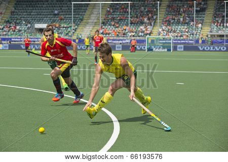 THE HAGUE, NETHERLANDS - JUNE 2: Matt Ghodes (AUS) tries to cross the ball using a backhand strike whilst Spanish Defender Sergi Enrique rushes in to block the shot. AUS beats SPA 3-0