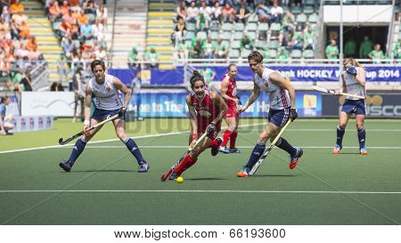 THE HAGUE, NETHERLANDS - JUNE 1: USA fieldplayer Gonzales is playing the bal towrads the goal during the Hockey World Cup 2014 in the match between USA and England (women) USA beats ENG 2-1