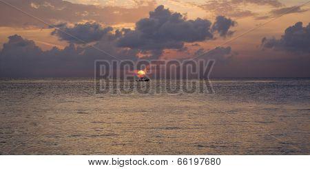 Boat in Caribbean sunset