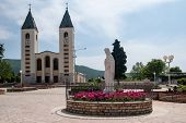 Pilgrimage church and Virgin Mary statue in Medjugorje, Bosnia and Herzegovina poster
