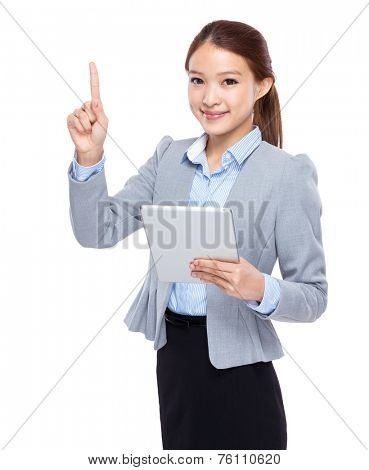 Businesswoman use of tableta and finger point up
