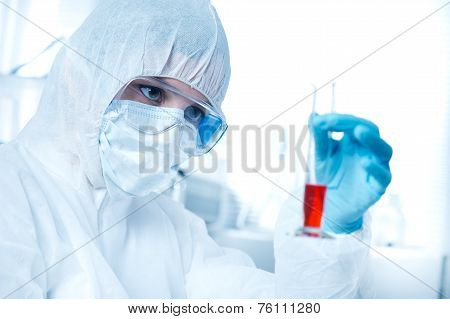 Researcher In Hazmat Suit With Test Tube