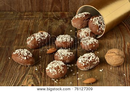 Cookies with coconut chips on a wooden background, selective focus poster