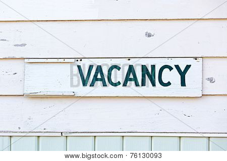 An old fashioned vacancy sign on an old motel. poster