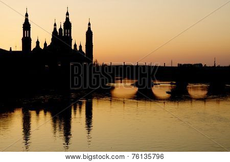 View of the  basilica of the Virgen del Pilar and Ebro river, right is located the medieval bridge known as the Stone Bridge, Zaragoza, Aragon, Spain poster