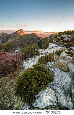 The morning sun was just starting to hit the peaks of the mountains as seen in the distant peak of Table Rock mountain. taken from the Chimneys in Linville Gorge. poster